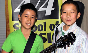 two guitar students