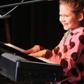 little girl playing keyboard