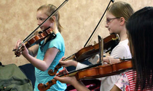 violin students warming up